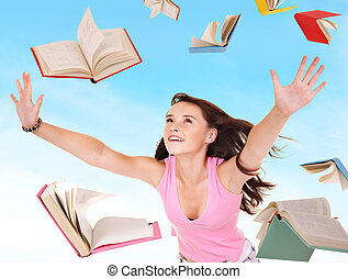 Student girl holding pile of books Outdoor