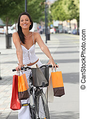 Woman with shopping bags cycling