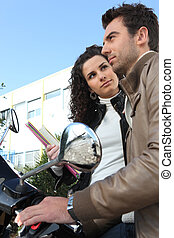 Urban couple on a moped