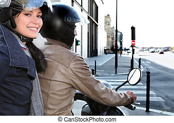 Trendy couple on a moped