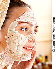 Woman having clay facial mask - Beautiful girl having clay...