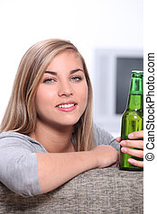 Young woman with a bottle of beer