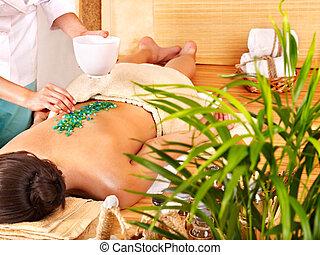 Salt massage - Young woman getting salt massage