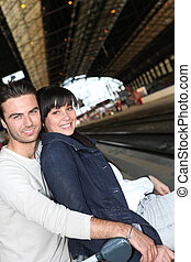 young couple waiting for the train