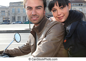Couple sitting on a motorcycle