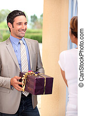 Man delivering present to woman