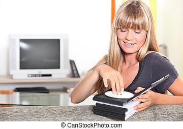Female teenager choosing DVD