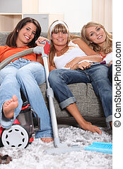 Three young housemates doing the chores