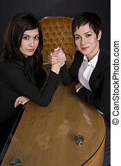 Business Woman Arm Wrestle - Two Business Woman Arm Wrestle...