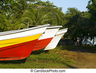 fishing boats on land Big Corn Island Nicaragua - native...