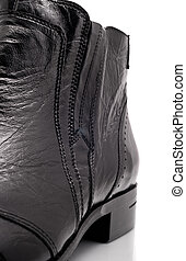 Closeup of Black leather mens boot over white background