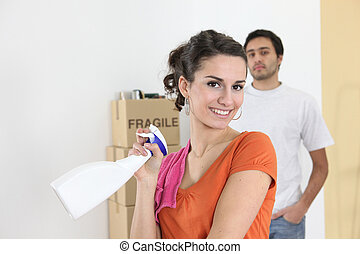 Couple cleaning house before move