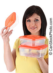 Woman presenting plastic boxes