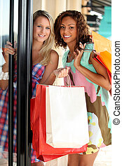 portrait of two girls with shopping bags