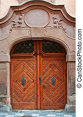 Massive wooden door, image is taken in Prague