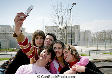 Teens taking a picture of themselves with a mobile phone