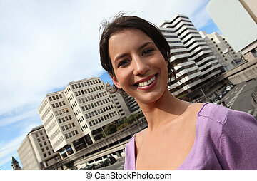 Young brunette in city centre