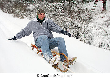 sleigh ride down mountains at - young people have fun in the...