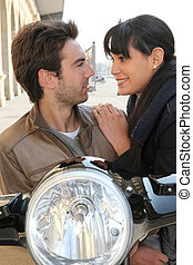 Couple behind their motorcycle
