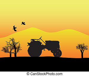 tractor in the background of trees and mountains