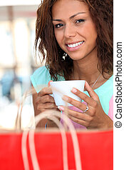 Woman having coffee after shopping