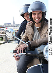 Young couple having a motorbike ride