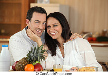 couple shining with happiness at breakfast
