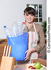 Woman taking out the recycling