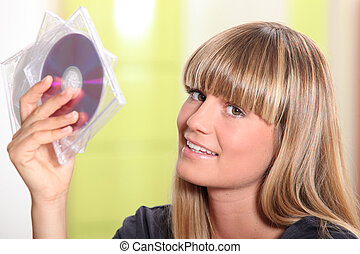 portrait of a woman holding CDs