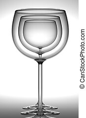 Simple refraction - Three wineglasses standing in row over...