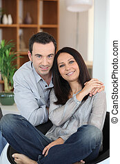 portrait of young couple posing at home