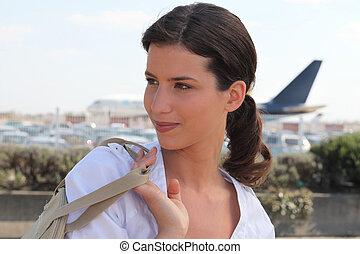 a woman near an airport
