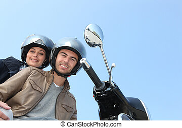 two people on scooter