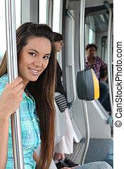 portrait of a woman in public transportation