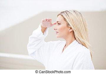 woman in bathrobe and looking into the distance - attractive...