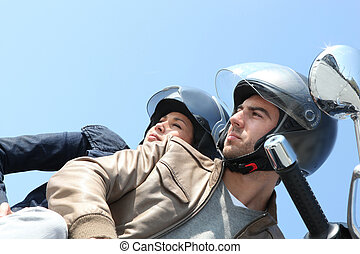 Couple on a scooter outdoors