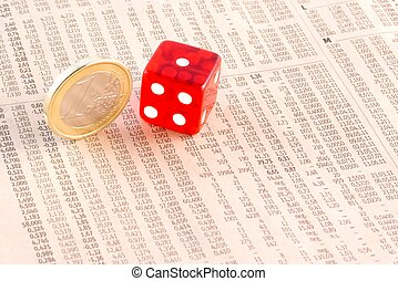 euro coins and a red dice on the financial newspaper