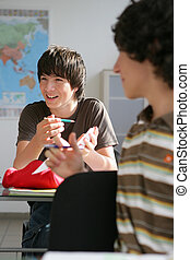 Boy laughing in classroom