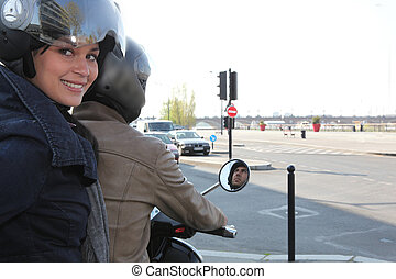 Woman riding on a scooter