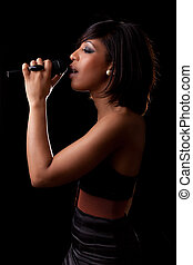 Young black singer performing at concert - Young african...