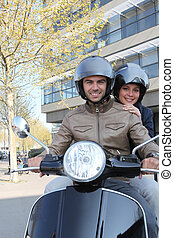 couple of young smiling bikers