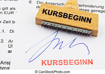 a stamp made of wood lying on a document. german...