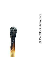 a burnt match up close against a white background