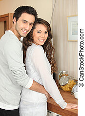 couple embracing in the kitchen
