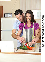 Man and woman preparing a meal together