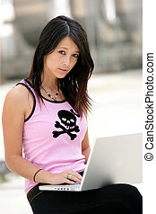 Young woman using Wi-Fi hot-spot in the city