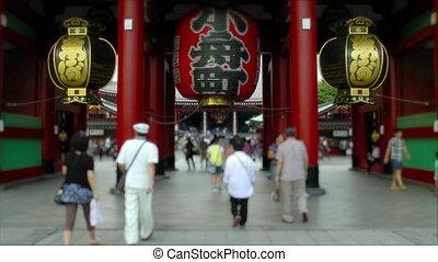 Visitors entering Senso-Ji Temple
