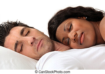 Woman sleeping on her husband's chest