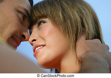 Young couple hugging tenderly