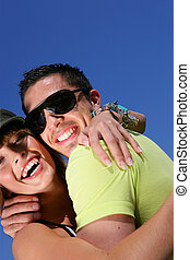 Embraced couple laughing